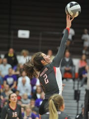 Emily Stump tips on over the net in the regional semifinal.