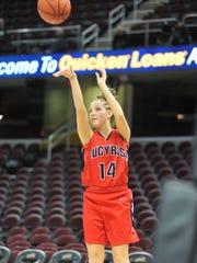 Alivia Lewis shoots a mid-range jumper.