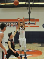 Galion's Isaiah Alsip attempts a 3-pointer.