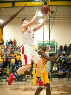 Delsea's Kobey Evans shoots over Nottingham's Deonte West during the Group 3 boys basketball state semifinal game played at Brick Memorial High School on Thursday.