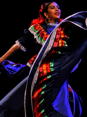 "Julissa Ruiz dances during ""Fiesta at the Paramount"" in April. The musical show at the Paramount Theatre featured the dancers from Ballet Folklorico del Big Country and Mariachi Sol Azteca of the Grand Prairie Fine Arts Academy."
