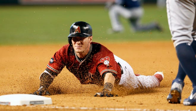 Arizona Diamondbacks' Chris Herrmann dives into third base after hitting a triple against the San Diego Padres in the seventh inning during a baseball game, Sunday, May 29, 2016, in Phoenix.