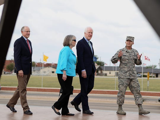 Tech. Sgt. Aaron Dvorak, 315th Training Squadron geospatial intelligence analysis course chief at Goodfellow Air Force Base, leads U.S. Senator John Cornyn (right), his wife Sandy and U.S. Representative Mike Conaway on a tour of a MQ-1 Predator, an unmanned aerial system, during their visit to the base Monday, April 10, 2017.