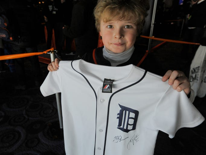 Wally Knysz, 9, of Lake Angelus holds up his jersey