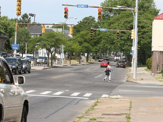Pedestrian traffic is a constant along Driving Park Avenue, at the intersection with Dewey Avenue in Rochester Friday, July 1, 2016.