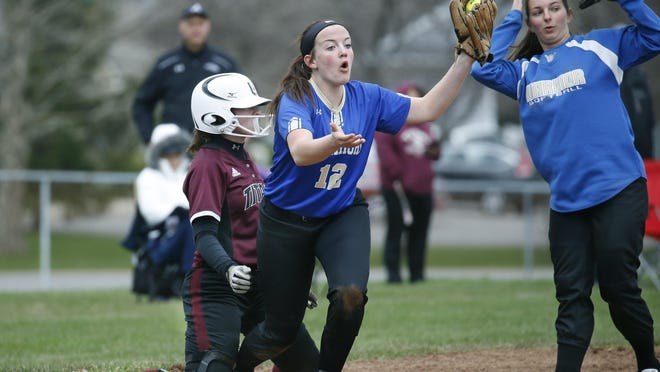 Webster Schroeder's Emily Willis-Nersinger and teammate Sabrina Smith claim a tag but Greece Arcadia's Rebecca Dow would be safe on third base in the first inning Wednesday.