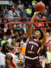 Henderson County's Cartel Gilbert (1) shoots over Hopkinsville's Stephen Cager (2) during their Boys Second Region Tournament semifinal game at Hopkinsville High School in Hopkinsville, Monday, March 6, 2017. Hopkinsville beat Henderson County 73-67.