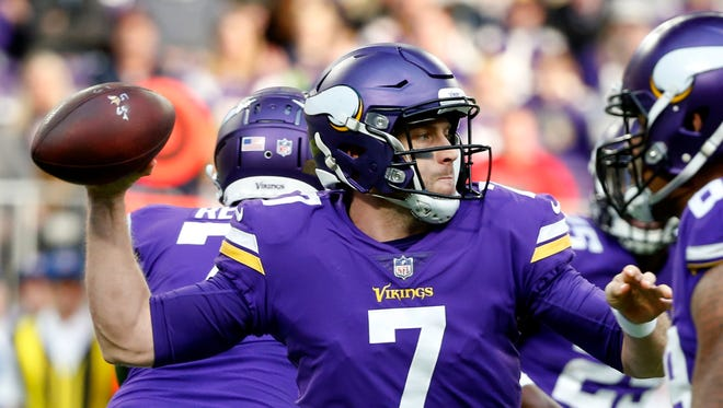 Minnesota Vikings quarterback Case Keenum throws a pass during the first half of an NFL football game against the Chicago Bears, Sunday, Dec. 31, 2017, in Minneapolis.