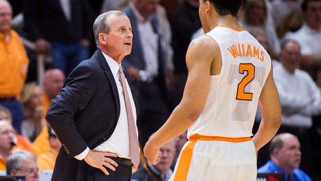 Tennessee head coach Rick Barnes speaks with Tennessee forward Grant Williams (2) during Tennessee's home basketball game against UNC at Thompson-Boling Arena on Sunday, Dec. 17, 2017.