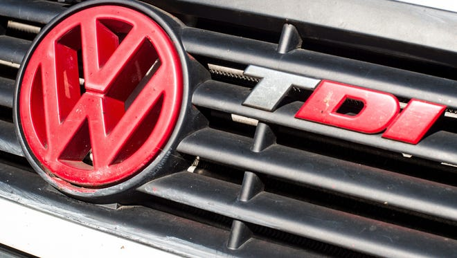 A red Volkswagen logo on a diesel-powered vehicle next to the abbreviation TDI (Turbocharged direct injection)in Frankfurt