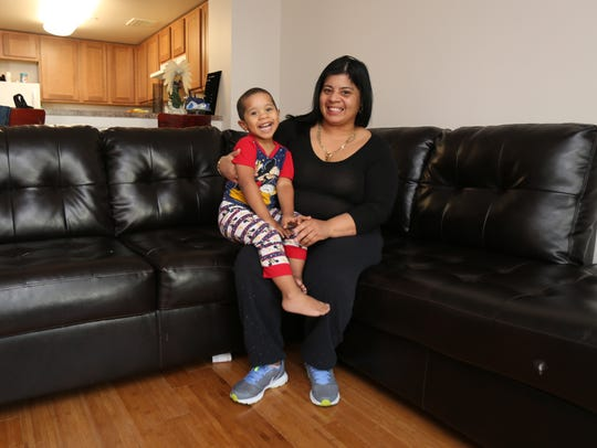 Carmen Morales and her grandson Felix Lopez, 2, are