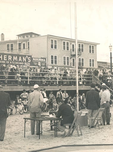 """Archived photos from the Wildwood Historical Society show """"mibsters,"""" or marbles players, competing in the National  Marbles Tournament."""