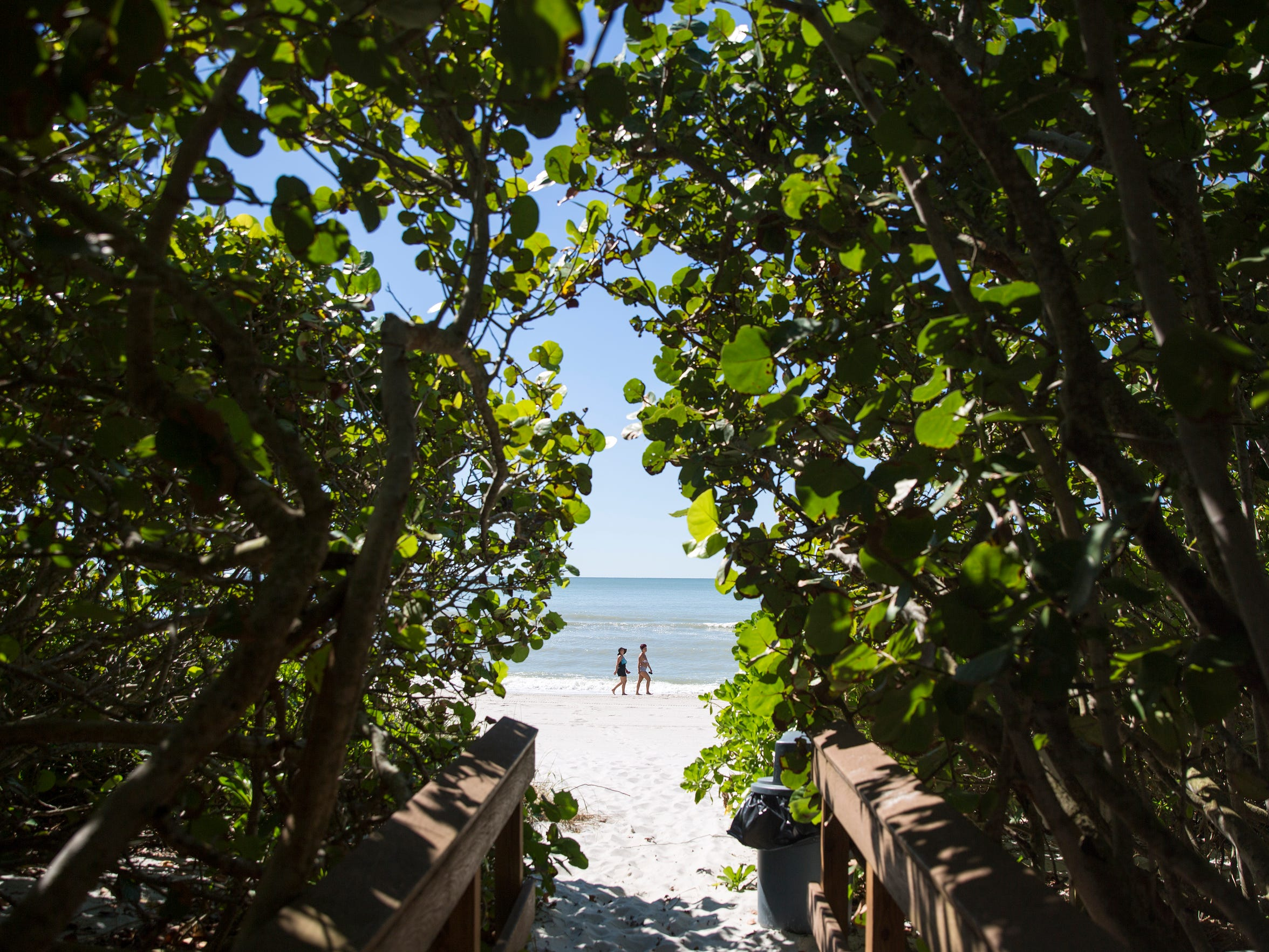 Beachgoers enjoy the private stretch of beachfront for residents of the Moraya Bay Beach Tower and Vanderbilt Gulfside II Condo, which is next to the public Bluebill Beach Access point in Naples, as seen on Thursday, Oct. 26, 2017.