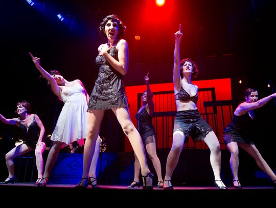 Actresses perform a scene from Chicago during a rehearsal