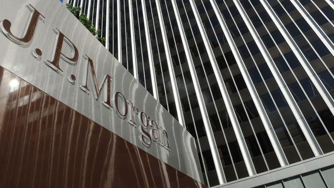 A JPMorgan sign is seen outside the office tower housing the financial services firm's Los Angeles offices.