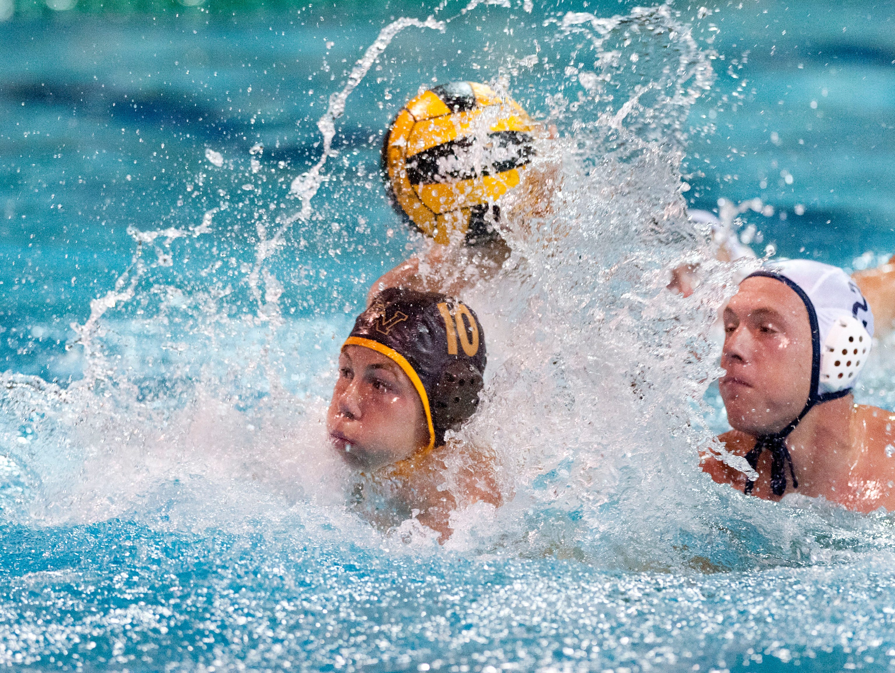Golden West's Sawyer Nordell under pressure from Redwood's Sam Peckinpah in WYL boys water polo on Wednesday, October 8, 2014.