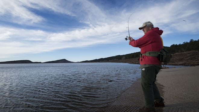 A member of the Loveland Fishing Club, Bill Prater, casts from the Northwest boat launch on Friday morning, March 16, 2018, at Carter Lake in Larimer County, Colo.
