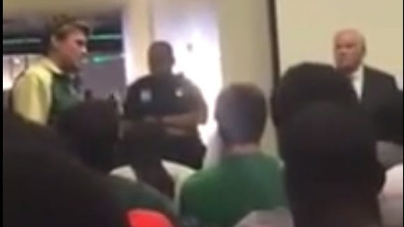 A UAB player stands up to be heard after being told the football program was ending at the school.