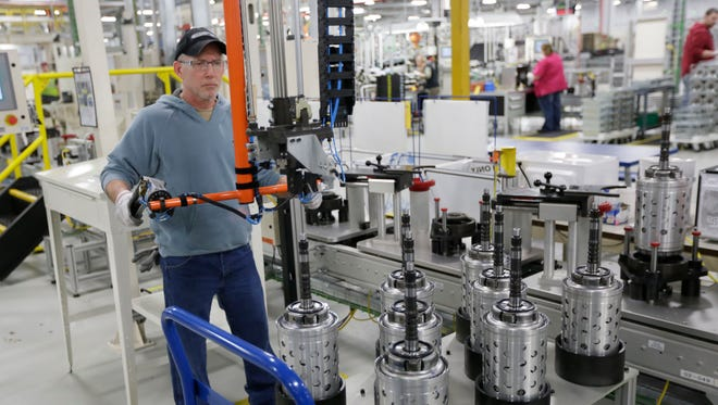 Dietz Werland works on the assembly line during a media tour before an investment and jobs announcement event at the Chrysler transmission plat in Kokomo, Ind., on Feb. 28, 2013.