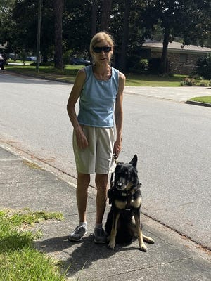 Marj Schneider and her guide dog out on a walk are concerned about unleashed dogs that could harm them both.