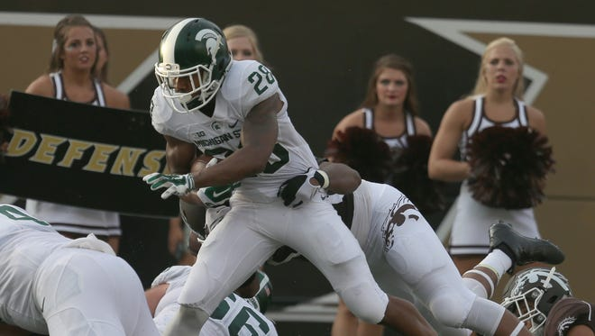 Michigan States running back Madre London scores a touchdown against Western Michigan on Sept. 4, 2015 in Kalamazoo.