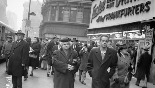 General scene showing Christmas Eve shoppers near Macy's in New York, Dec. 24, 1946.