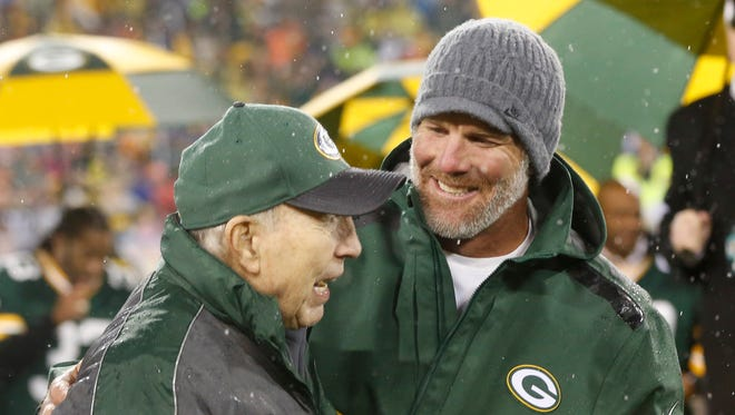 Brett Favre smiles with Bart Starr during a halftime ceremony on Thanksgiving night in 2015 at Lambeau Field.