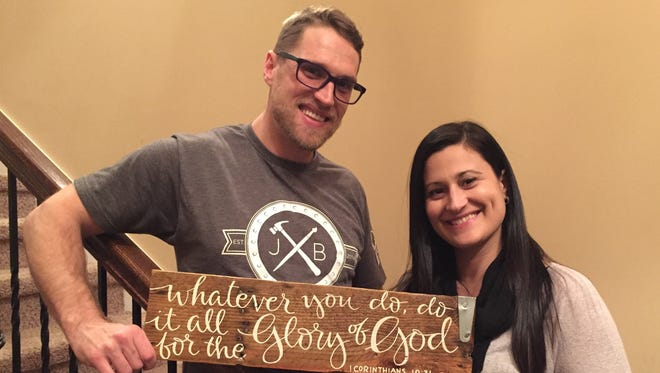 Justin and Jessica Beshearse of JB Designs in Smyrna work together to create shabby chic signs and furniture pieces.
