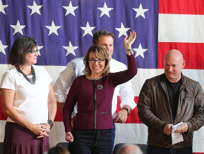 Former U.S. Rep. Gabrielle Giffords waves to supporters before speaking on Sunday during the Bruce, Blues and BBQ event at the Iowa State Fairgrounds in Des Moines.