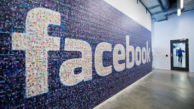 A big logo created from pictures of Facebook users worldwide is pictured in the company's Data Center, its first outside the US on November 7, 2013 in Lulea, in Swedish Lapland.