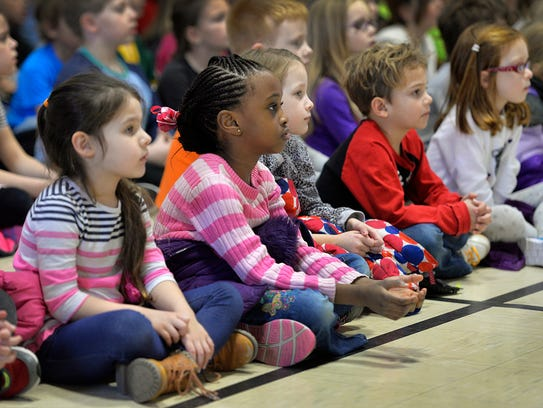 "Students watch the play ""Buzz,"" about a bee that has"