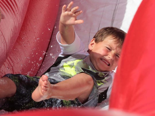 Bentley Parker on the waterslide at the last day of