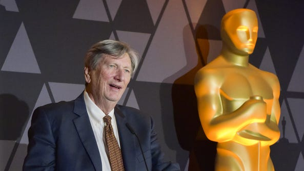 Academy president John Bailey speaks onstage at a reception