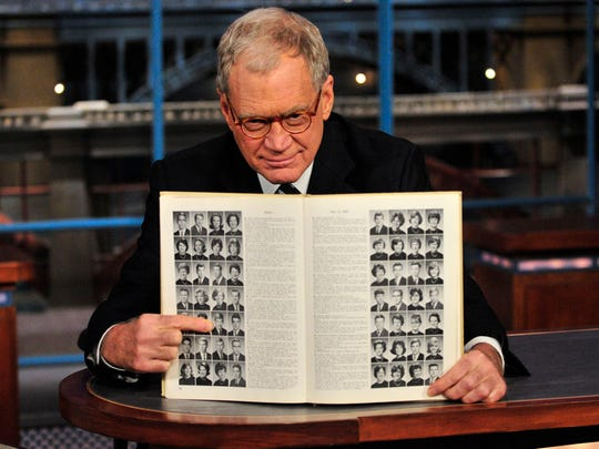 "David Letterman points to his Broad Ripple High School yearbook photo during a 2009 episode of ""Late Show."""