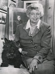 Eleanor Roosevelt poses with Fala, President Franklin