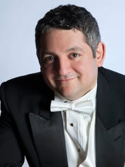 Maestro Julien Benichou is the music director of the