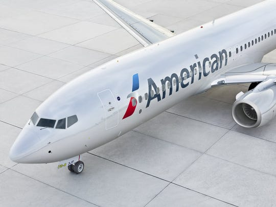 An American Airlines Boeing 737 pulling into a terminal gate.