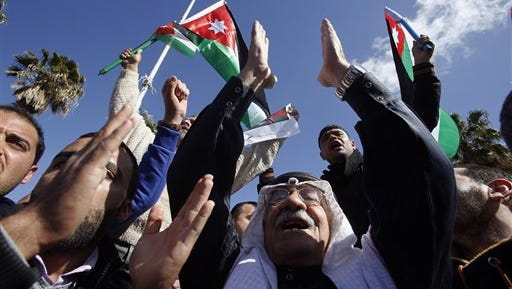 Jordanians chant slogans to show their support for the government against terror as they were waiting for Jordan's King Abdullah II, returning from the U.S., at Queen Alia Airport in Amman, Jordan, on Wednesday, Feb. 4, 2015.