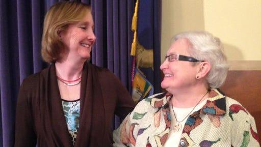Glenna DeJong and Marsha Caspar, of Lansing, preparing to celebrate their first wedding anniversary