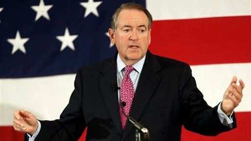 FILE - In this April 18, 2015 file photo, former Arkansas Republican Gov. Mike Huckabee speaks at the Republican Leadership Summit in Nashua, N.H. Huckabee is set to announce he will seek the 2016 Republican presidential nomination. He has an event planned for May 5 in his hometown of Hope, Ark., where former President Bill Clinton was also born.  (AP Photo/Jim Cole, File)