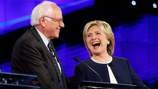 Sen. Bernie Sanders, of Vermont, and Hillary Rodham Clinton laugh during the CNN Democratic presidential debate Tuesday, Oct. 13, 2015, in Las Vegas.