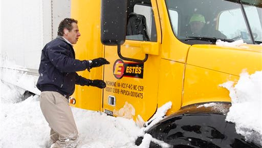 New York Gov. Andrew Cuomo checks on a snowbound trucker on the Thruway between Walden Ave. and Ridge Rd. in Cheektowaga, N.Y., Wednesday, Nov. 19, 2014.