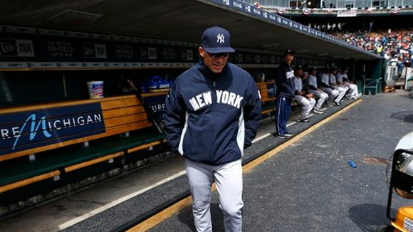New York Yankees manager Joe Girardi walks in the dugout against the Detroit Tigers in the first inning of a baseball game, Friday, April 8, 2016, in Detroit.