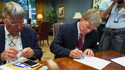 Former Ku Klux Klan leader David Duke registers his candidacy for the November 8 ballot as a Republican at the Louisiana Secretary of State's office in Baton Rouge, La., Friday, July 22, 2016. Duke's candidacy comes as the state is grappling with deep racial tensions after the shooting death of a black man by white police officers and the killing of three law enforcement officers by a black man. (AP Photo/Max Becherer)