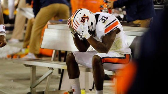 Auburn  defensive back Javaris Davis (31) sits on the bench in the finals moments of their 13-7 loss to Georgia in an NCAA college football game Saturday, Nov. 12, 2016, in Athens, Ga.