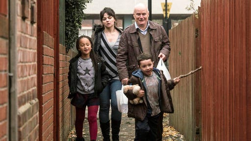 "This image released by Sundance Selects shows, from left, Briana Shann, Hayley Squires, Dave Johns and Dylan McKiernan, foreground right, in a scene from, ""I, Daniel Blake."""