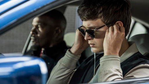 """This image released by Sony Pictures shows Ansel Elgort, right, and Jamie Foxx in a scene from """"Baby Driver."""" The 24th South by Southwest film festival announced it will premiere the film by writer-director Edgar Wright at the festival running March 10-19 in Austin."""