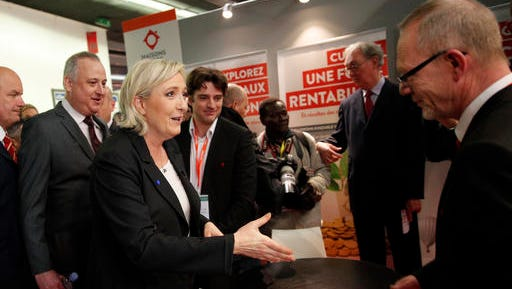 Far-right leader and candidate for next spring presidential elections Marine le Pen, center left, shakes hands as she visits the Entrepreneur Fair, Wednesday, Feb. 1, 2017 in Paris, France.