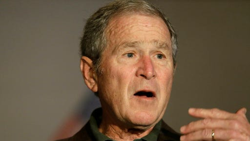 Former President George W Bush speaks during a preview of an exhibition of his paintings of U.S. military veterans in Dallas, Tuesday, Feb. 28, 2017. President Bush says he didn't intend to criticize President Donald Trump when he said recently that a free press is essential to democracy.