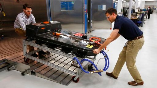 In this Nov. 4, 2016, file photo, a Chevrolet Bolt EV battery pack is removed for testing after undergoing charging and discharging cycles at General Motors Warren Technical Center's Advanced Energy Center in Warren, Mich. Gov. Rick Snyder's administration and economic development officials are readying a new push to offer tax breaks to attract large-scale business expansions. General Motors LLC, plans to amend the global MEGA incentive it received in June 2009 to add a Hybrid Electric Vehicle battery and vehicle engineering and development operation at the existing battery development center at the Warren Technical Center.